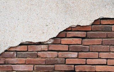 damaged masonry covering