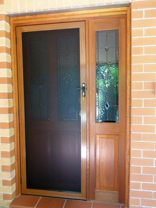 View of wooden door with window