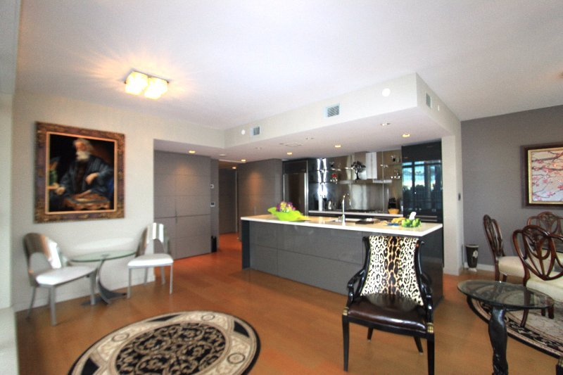 view of kitchen in a L'hermitage 2 bedroom and den condo rental in Vancouver, Canada presented by Rebecca Punch.
