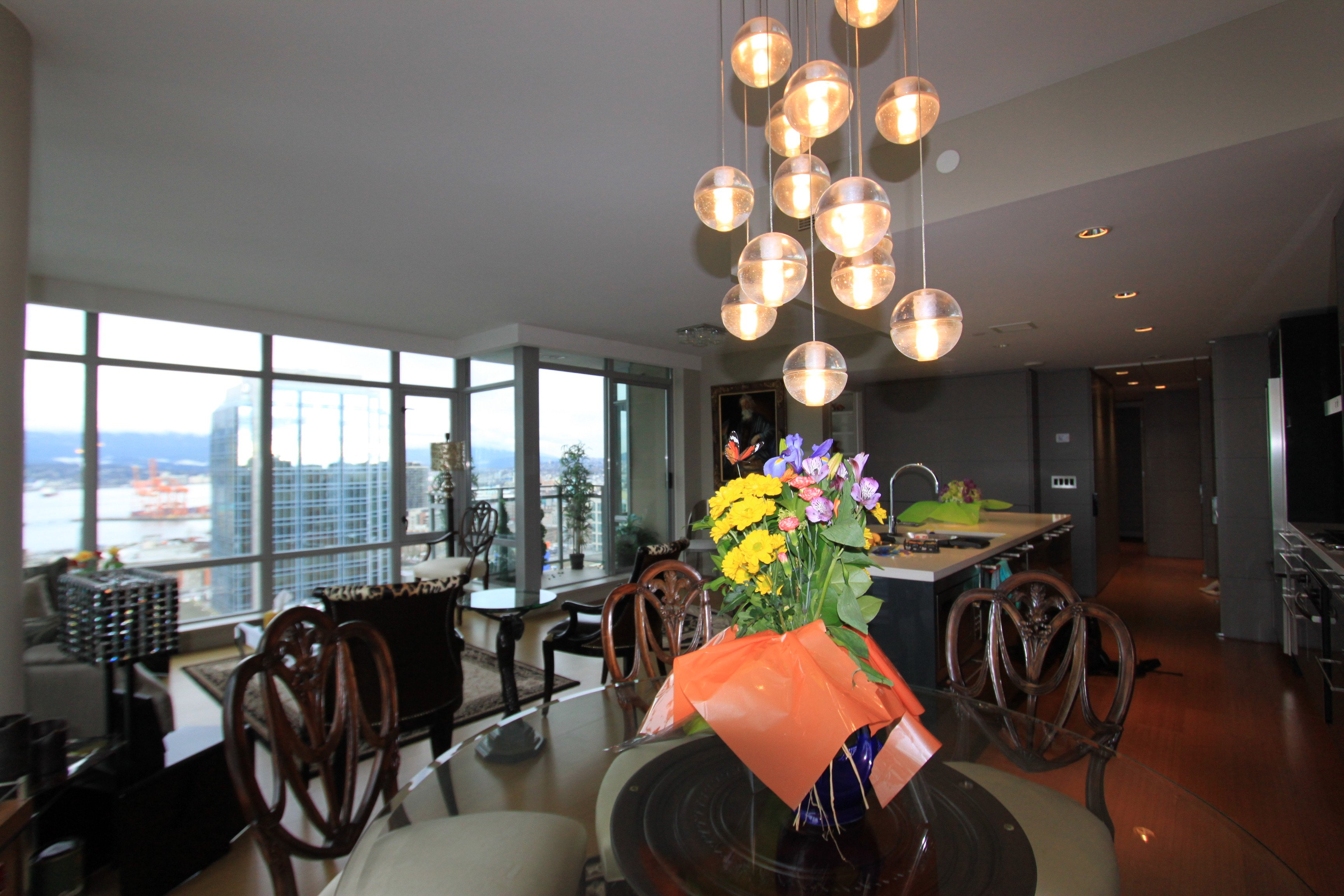 view of dining room in a L'hermitage 2 bedroom and den condo rental in Vancouver, Canada presented by Rebecca Punch.
