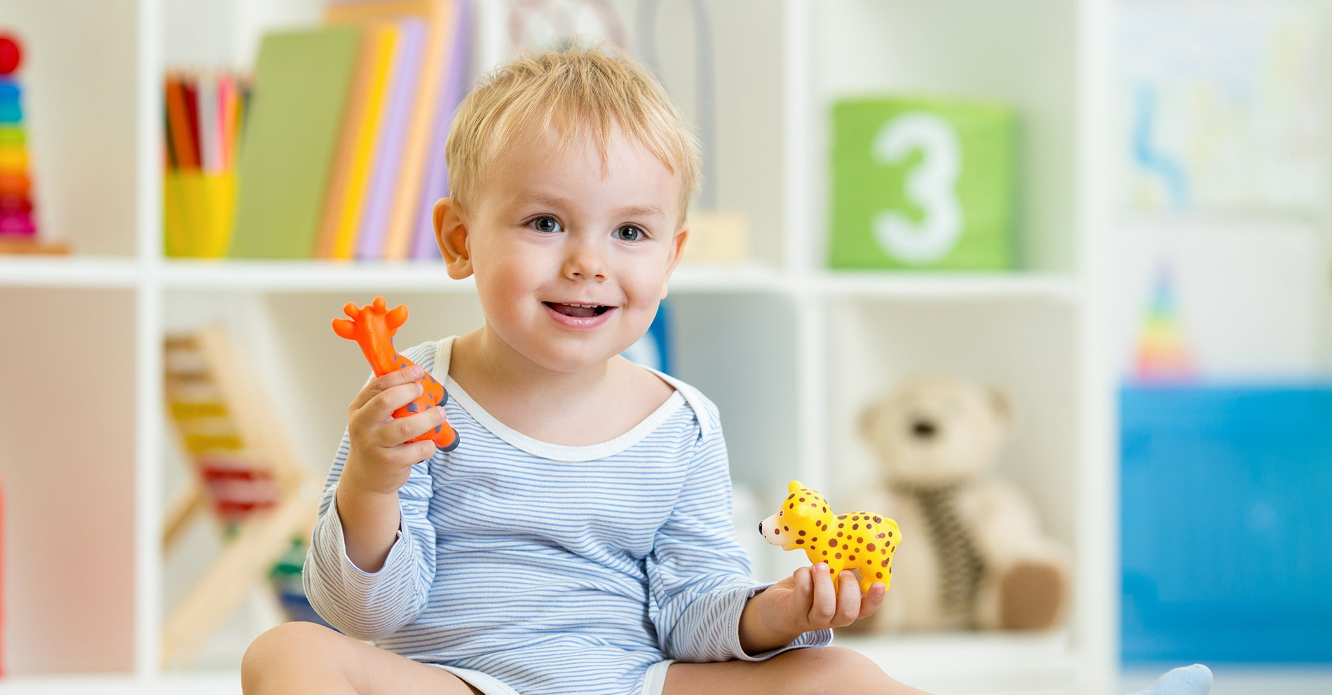 Smart child boy playing with toys