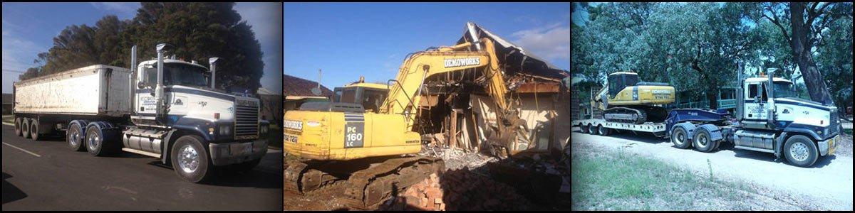 demoworks crane demolishing truck road