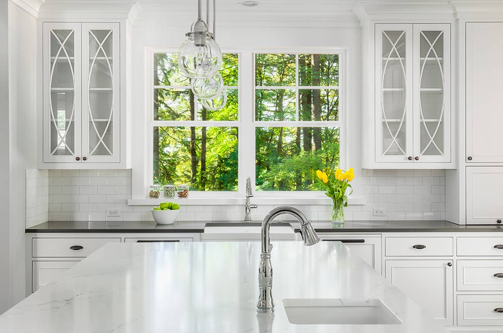 kitchen sink and windows and cabinets