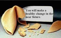 Fortune cookie with a note that reads :you will make a healthy change in the near future'