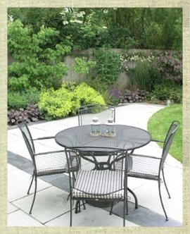 Paved patio area with table and chairs