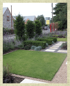 Modern front garden with turfed area and gravel and paved path