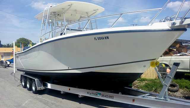 "SEA-TECH Aluminum Boat Trailer for a 30 - 32' boat up to 10,000 lbs includes 3 sets of Kodiak disc brakes and 7-1/2"" I-beams."