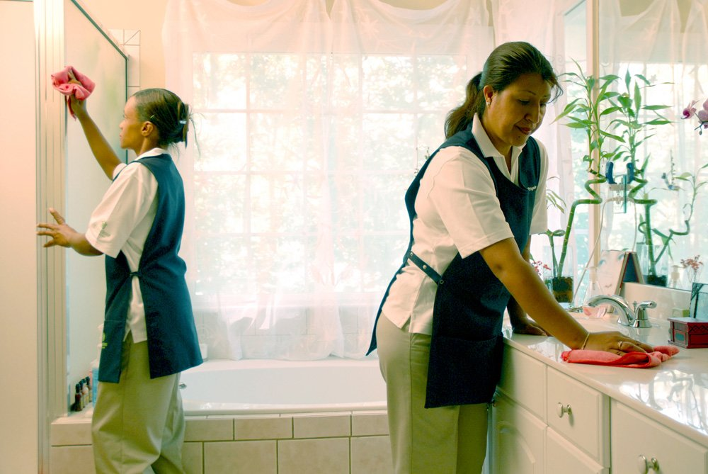 Maid Brigade employees cleaning bathroom in Vancouver