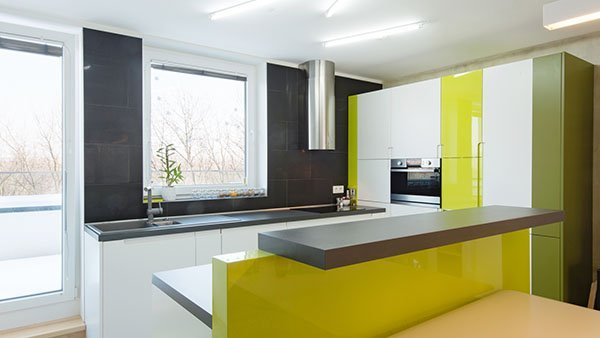 modern kitchen with green acrylic splashbacks