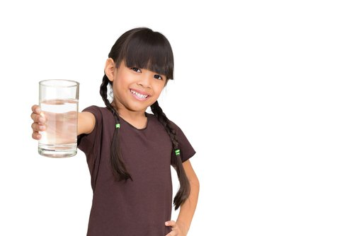 Young girl holding a glass of water in Rochester NY