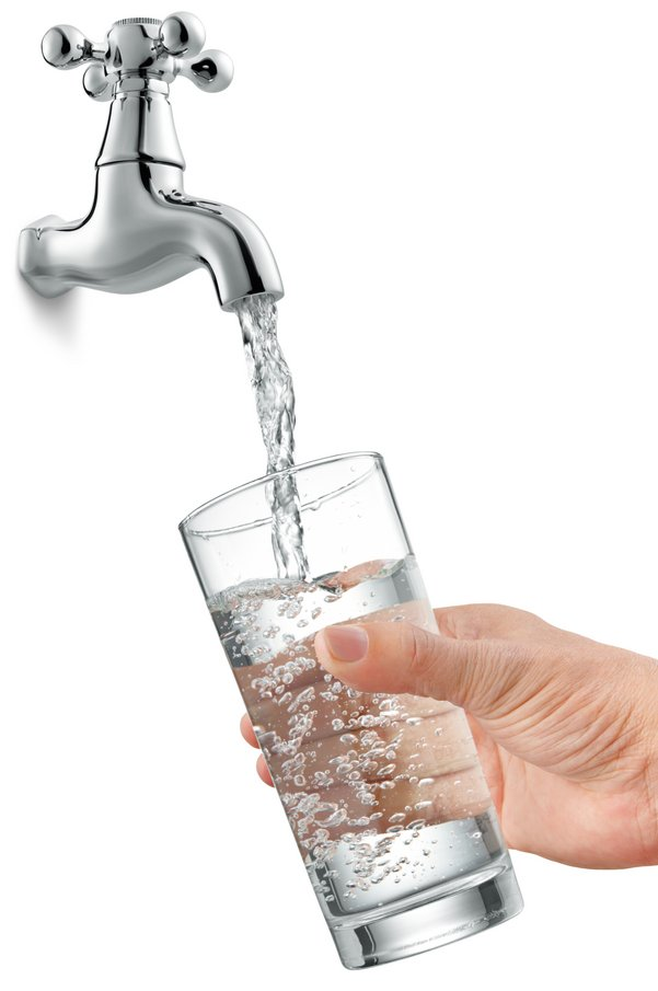 Clean water from the tap filling a glass