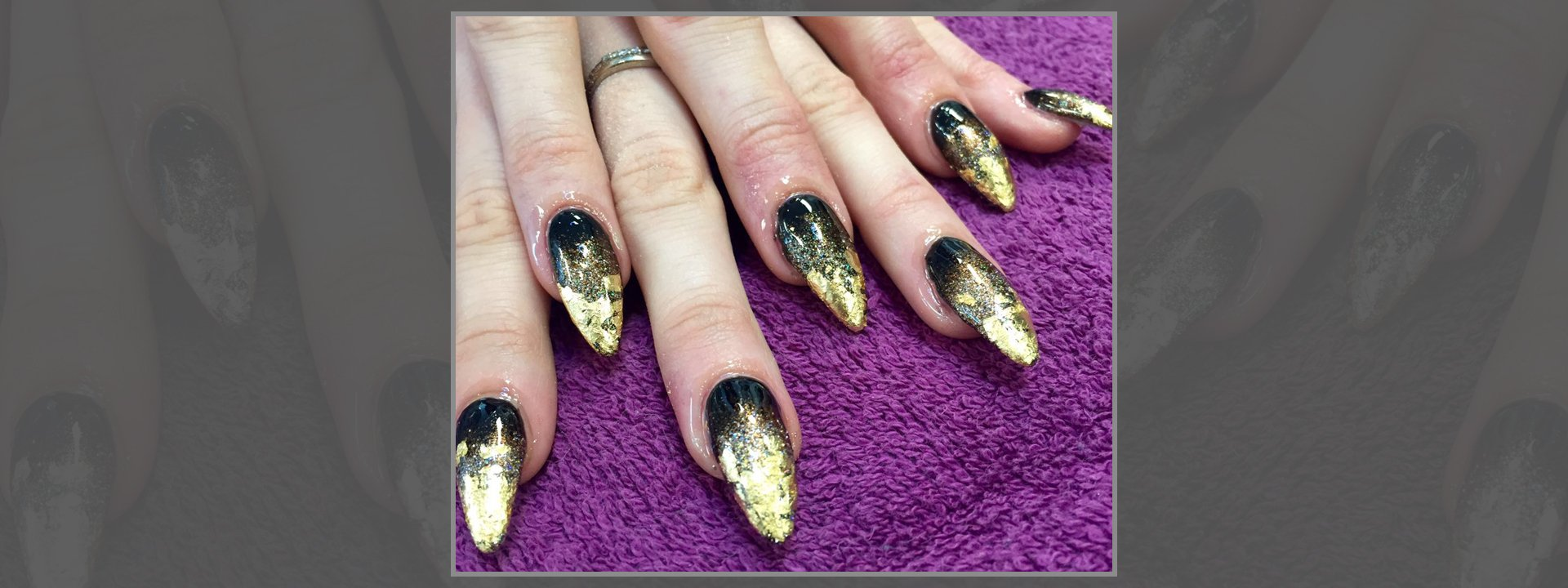 Black and gold nail extensions