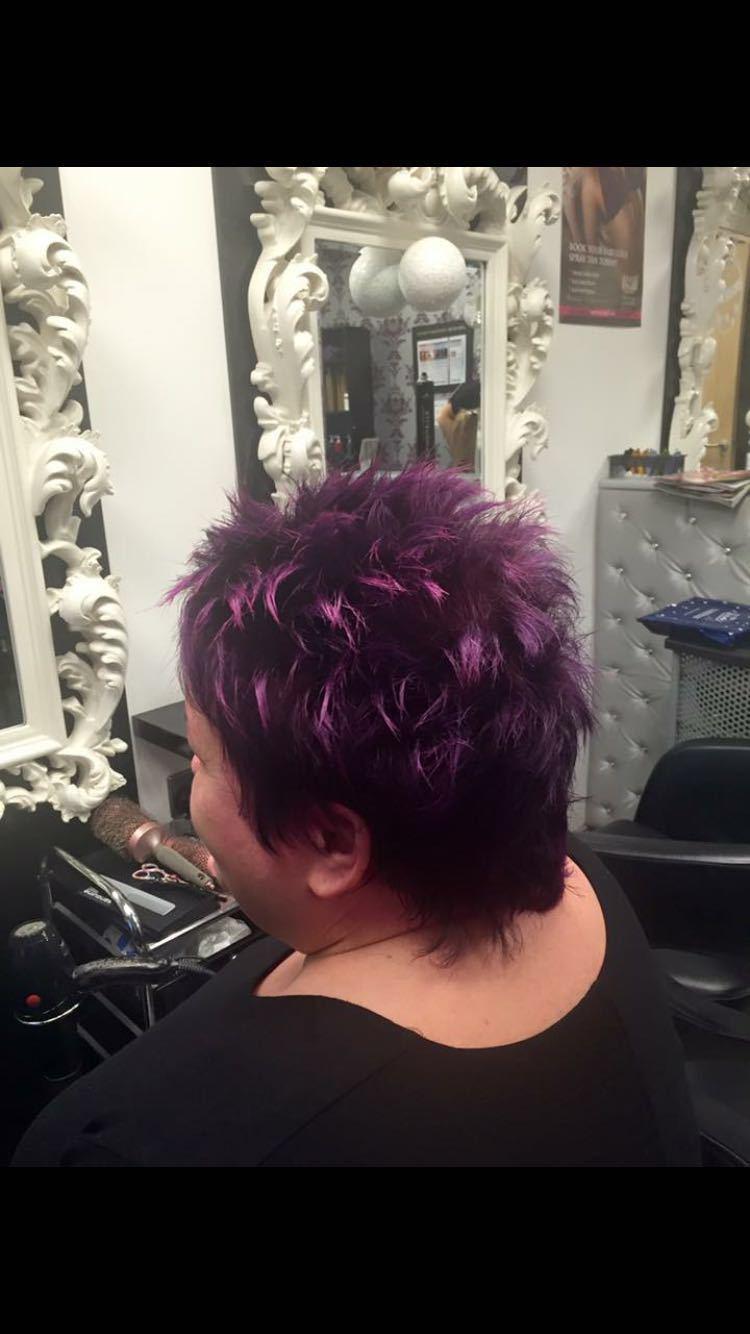 Short dark hair with purple highlights