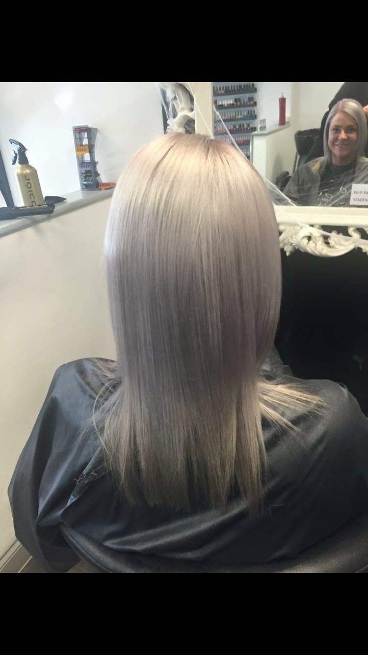 Long straightened silver-grey hair