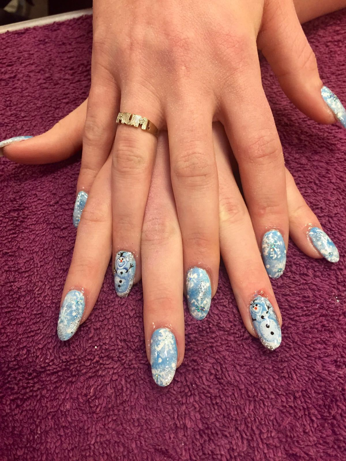 Sky blue nails painted with snowflake and snowman pattern