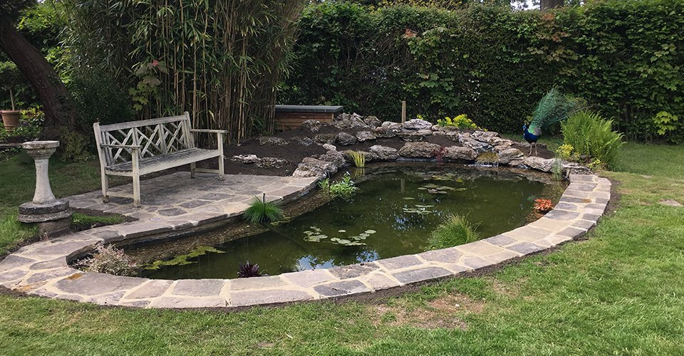 Beautiful garden ponds for your home in woking for Ornamental pond waterfall