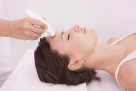 A lady having a microdermabrasion treatment