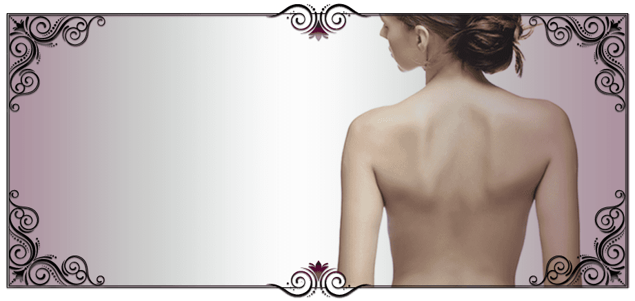 A lady showing off her back after a peel treatment