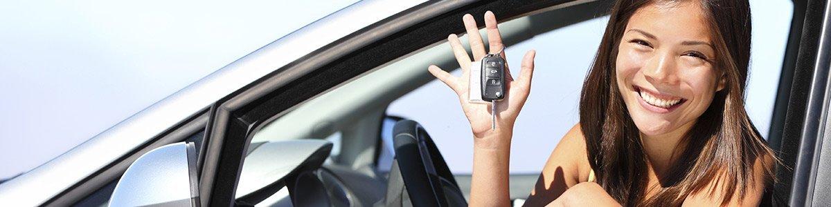 happy women with car key