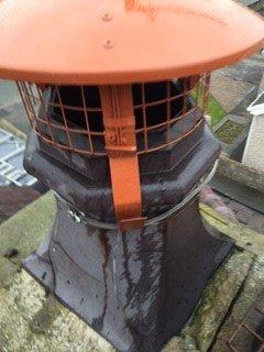 Bird cage on chimney