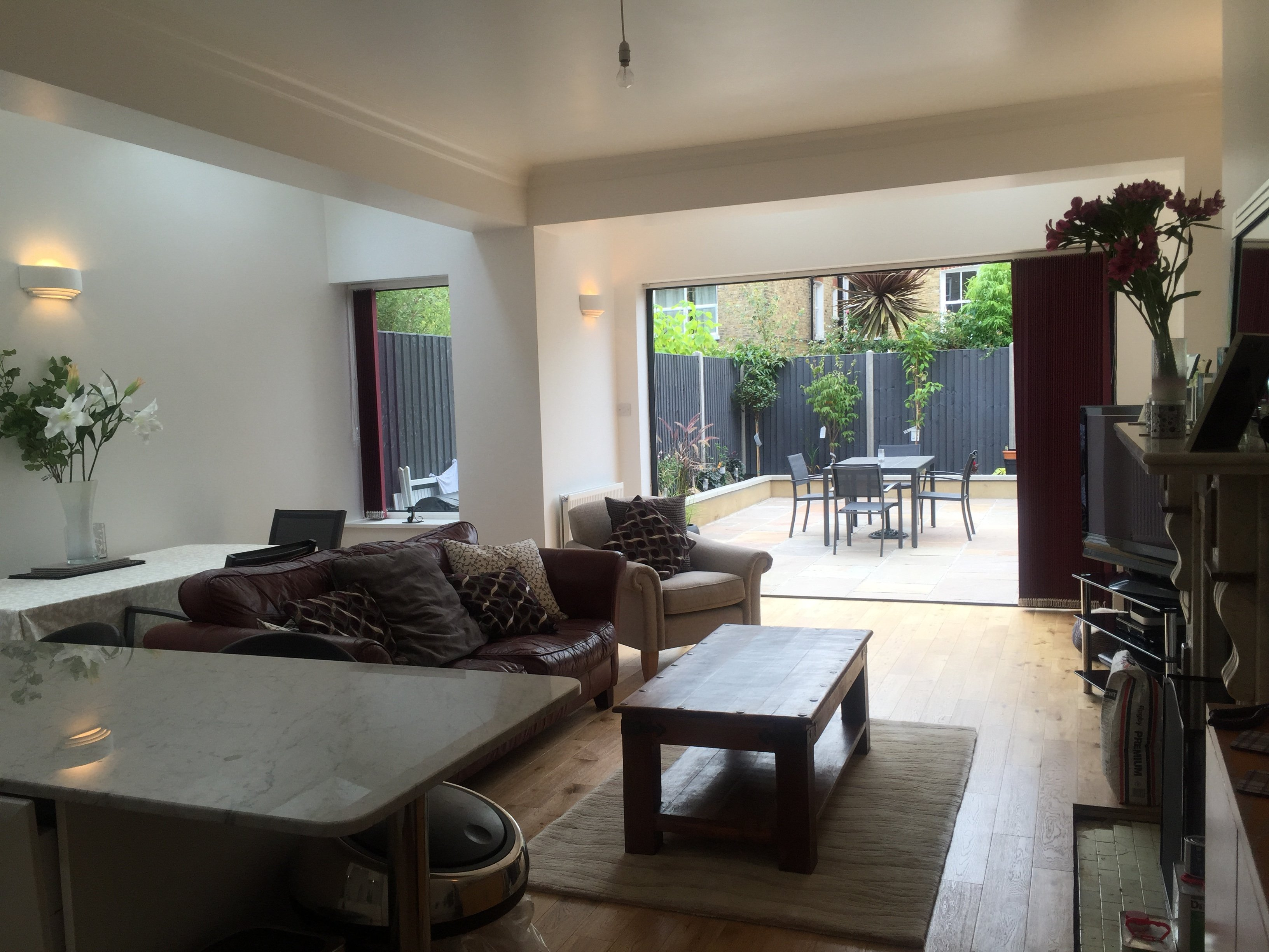 living room that opens into a outdoor sitting area