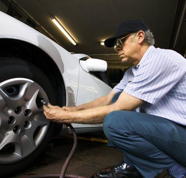 christies beach auto wreckers mechanic inflating tyre