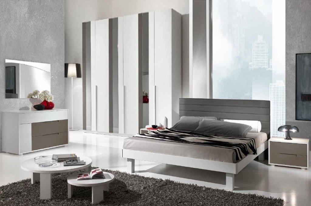 camera da letto bianca e grigia