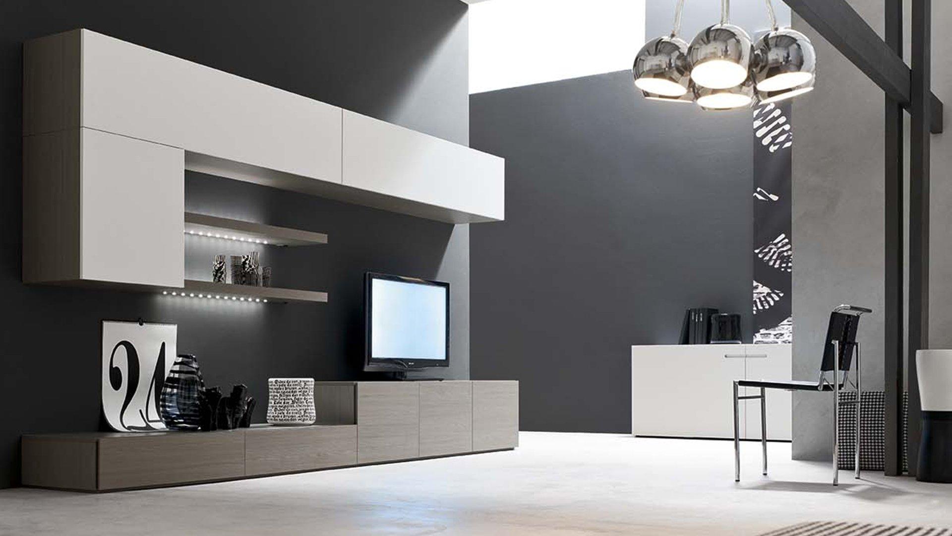 libreria con tv e sedia