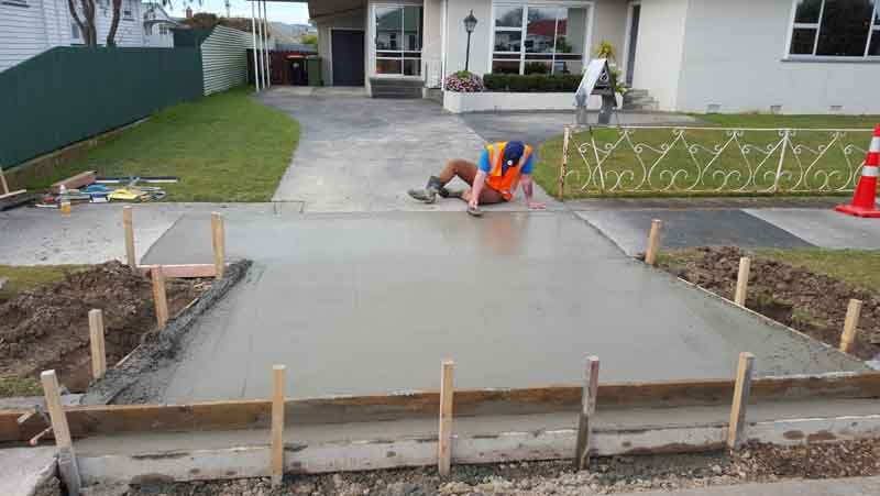Trowelling off a finished concrete vehicle crossing