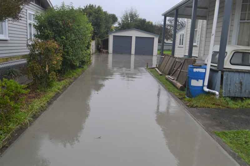 Freshly poured domestic concrete drive & footpath