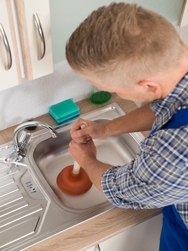 Plumber clearing blocked drains in Toowoomba