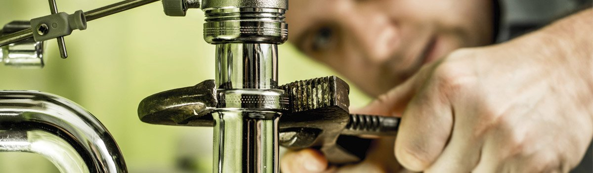 Plumber fixing a faucet in Toowoomba