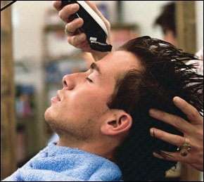 A gentleman getting his hair cut