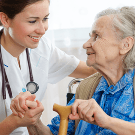 Aldersgate Village Skilled Nursing Nurse Helping Elderly Woman