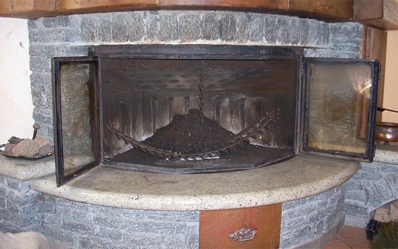 Pulizia inserto a legna ventilato