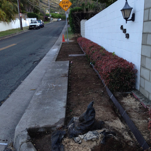 Pathway outside a residence in the process of transforming into a fantastic landscape design in Honolulu, HI