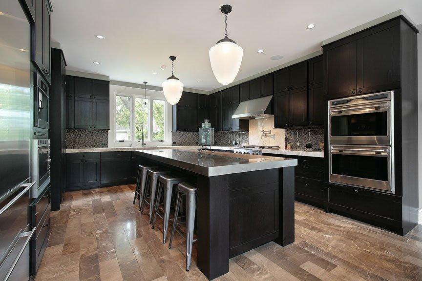modern kitchen with dark units and granite work surface