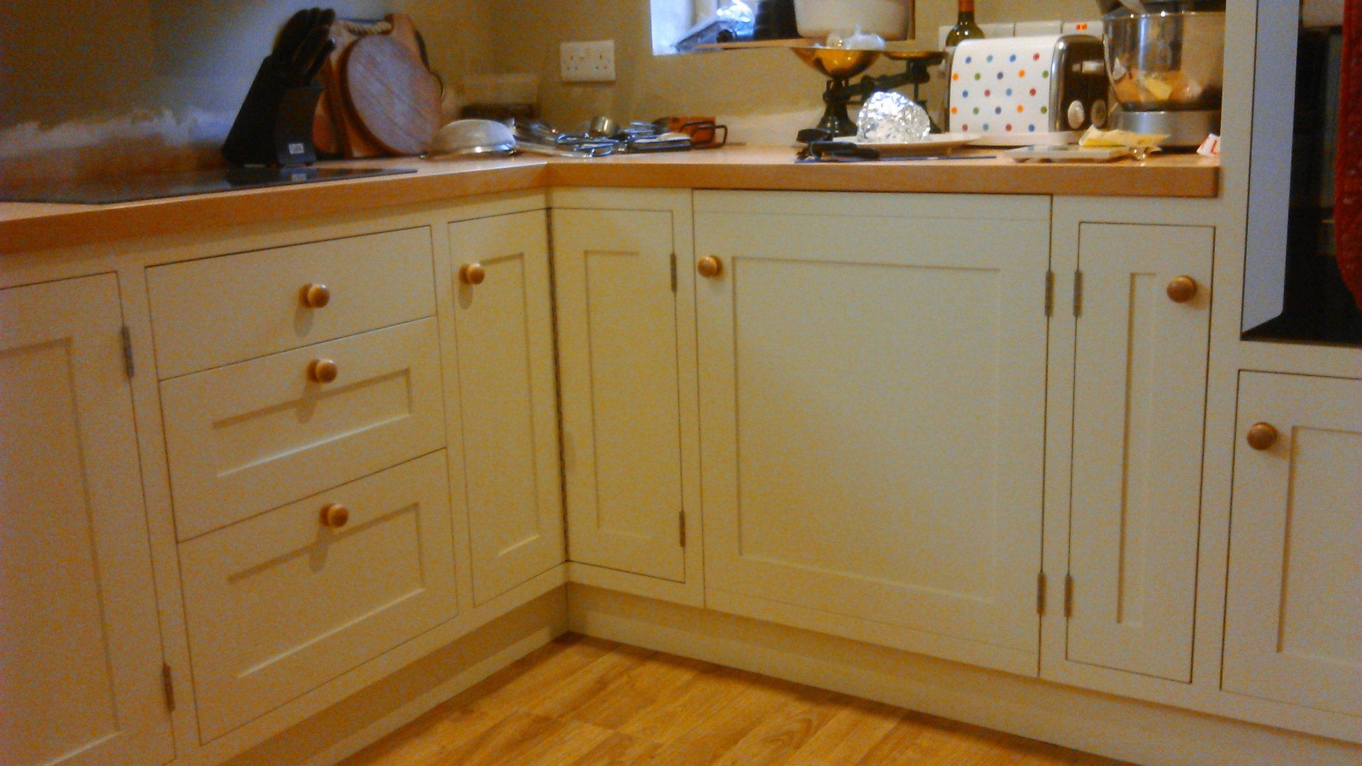 shaker style kitchen units in cream with wood worktops