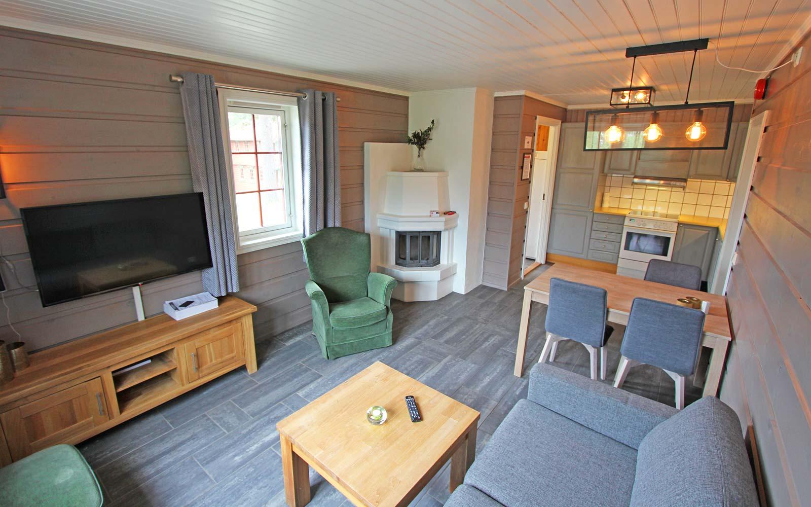 Stue og kjøkken i leilighet Stallen - Sjumilskogen booking Trysil