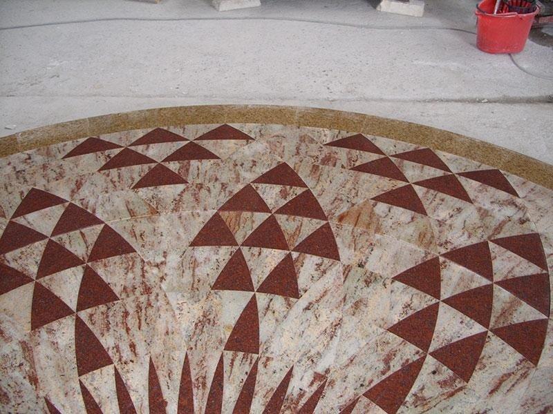 porzione pavimento granito intarsiato