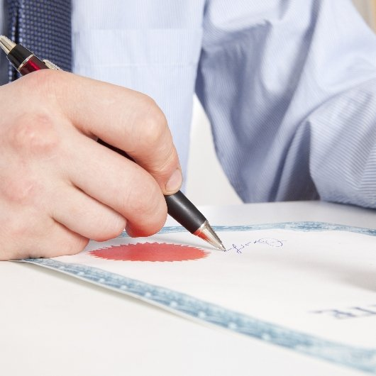 Attorney signing a legal document