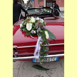 auto rossa per matrimonio