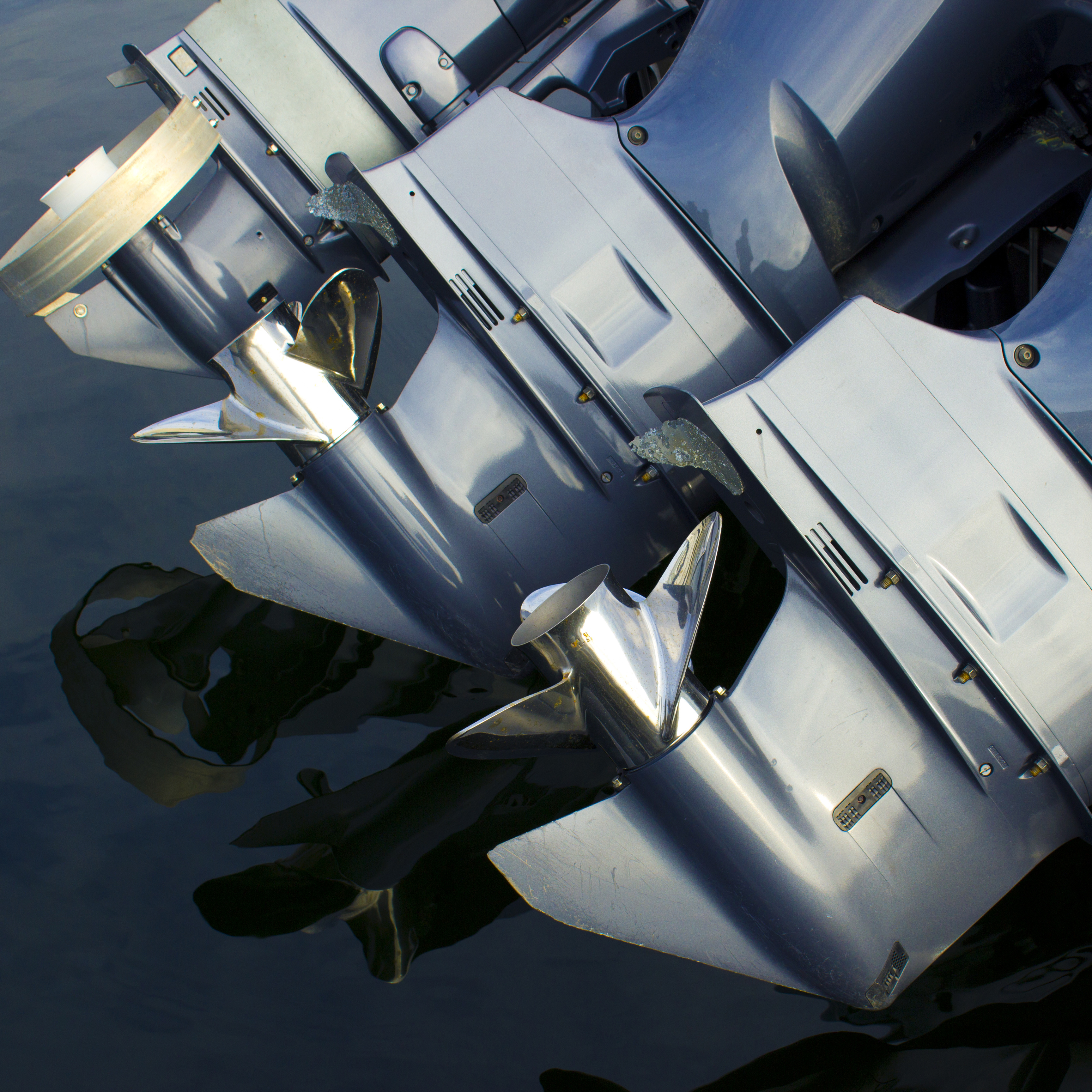 Three outboard motors lined up