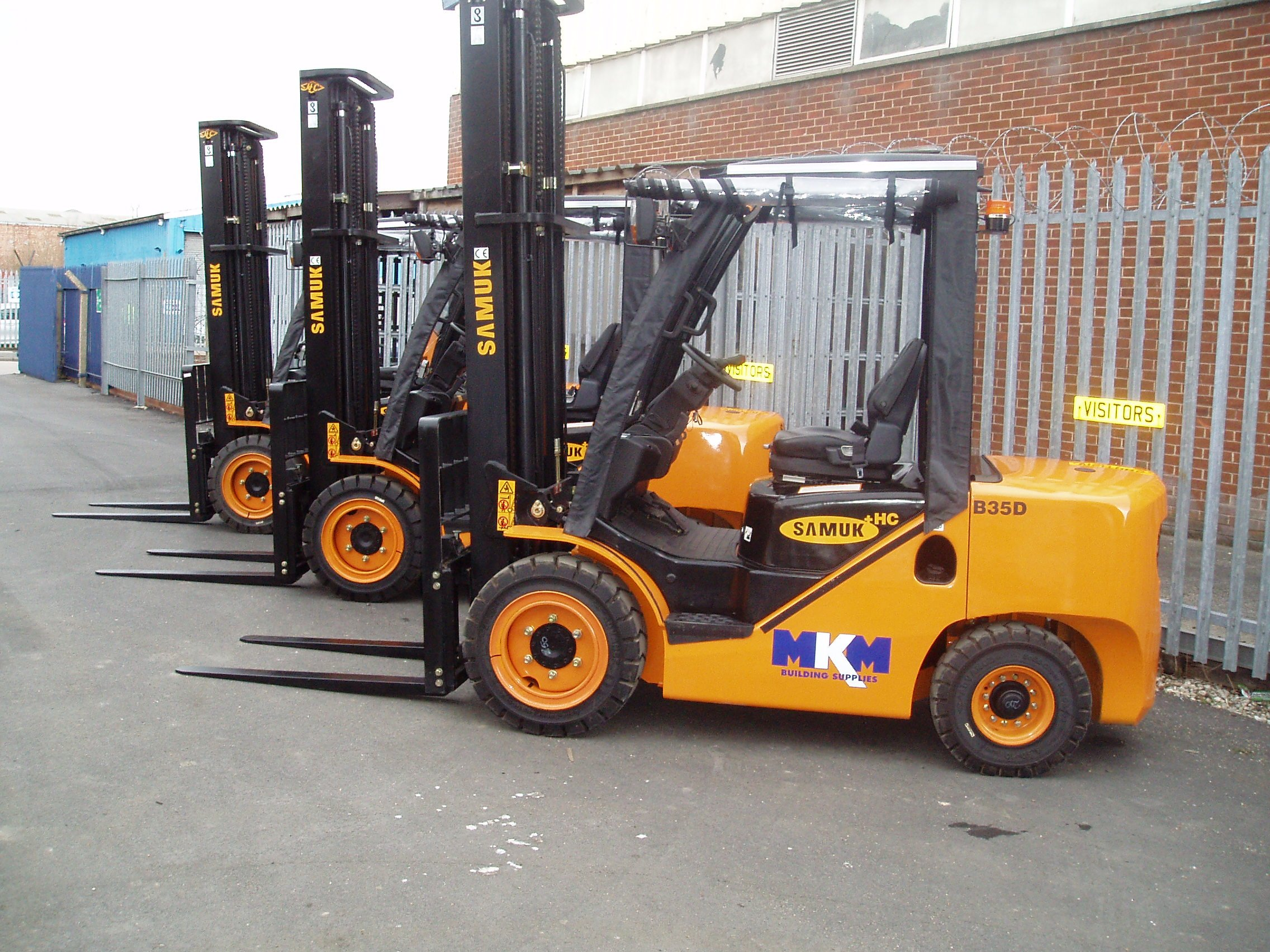 yellow forklifts parked