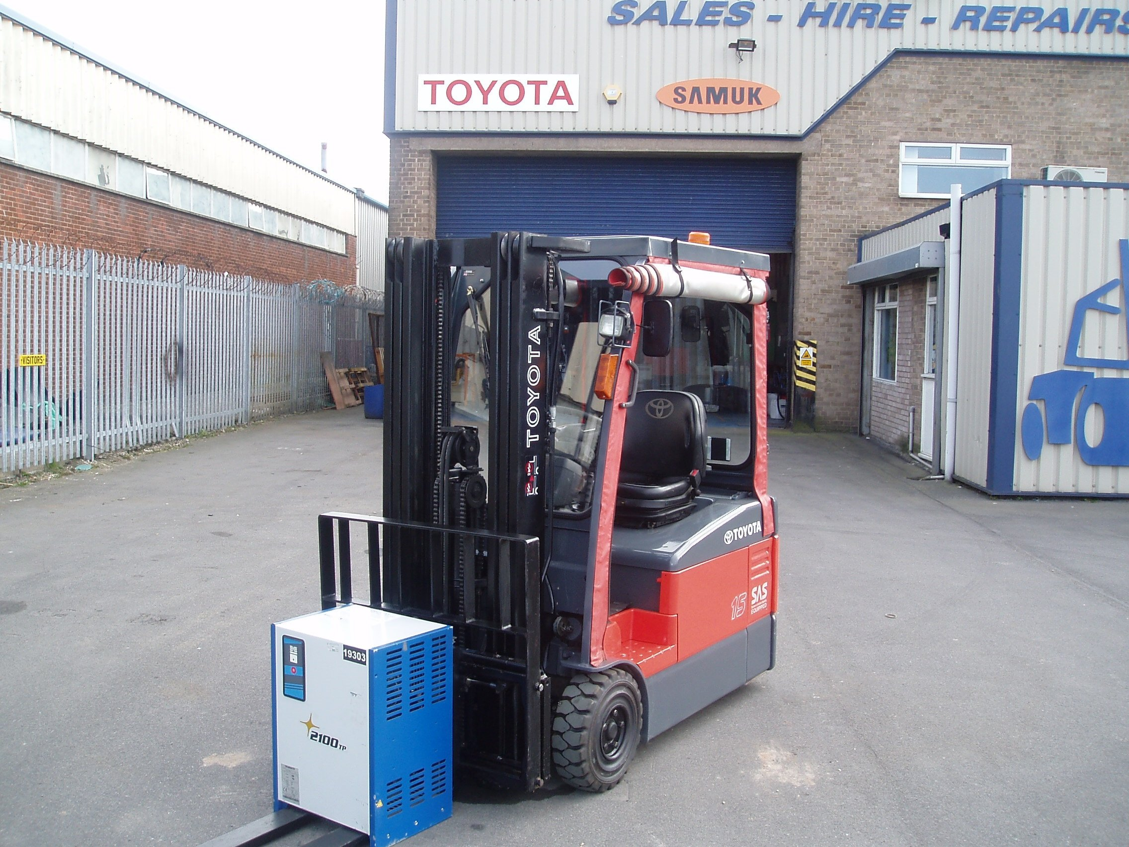 red forklift with goods