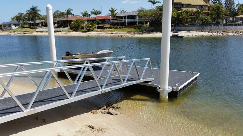 coastal pontoon and jetty repairs jetty and small motor boat placed in pontoon