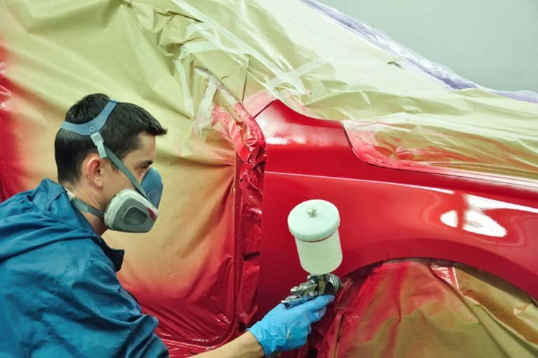 man-painting-car-red