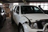 white-nissan-before-repairs