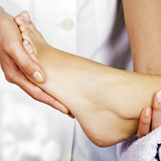 Experienced podiatrist helping a client in Blue Ash, Middletown, Mt. Airy and Cincinnati, OH
