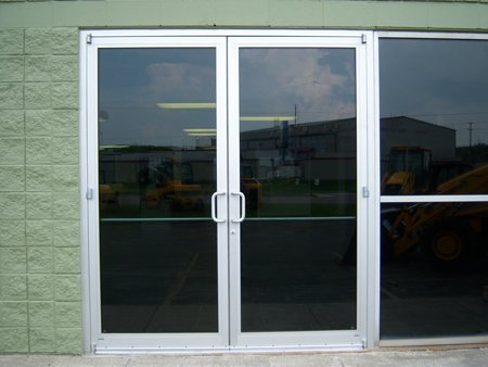 Residential and commercial garage doors photo gallery for Commercial entry doors